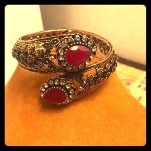 Jewelry - Cuff bracelet with ruby colored gems!